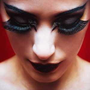 girl with exaggerated black makeup and large eyelashes