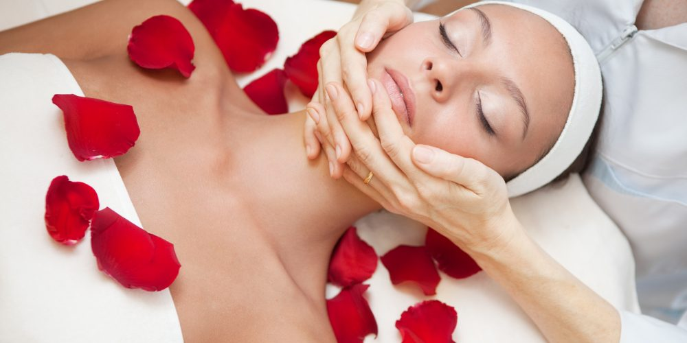 spa facial with red rose petals